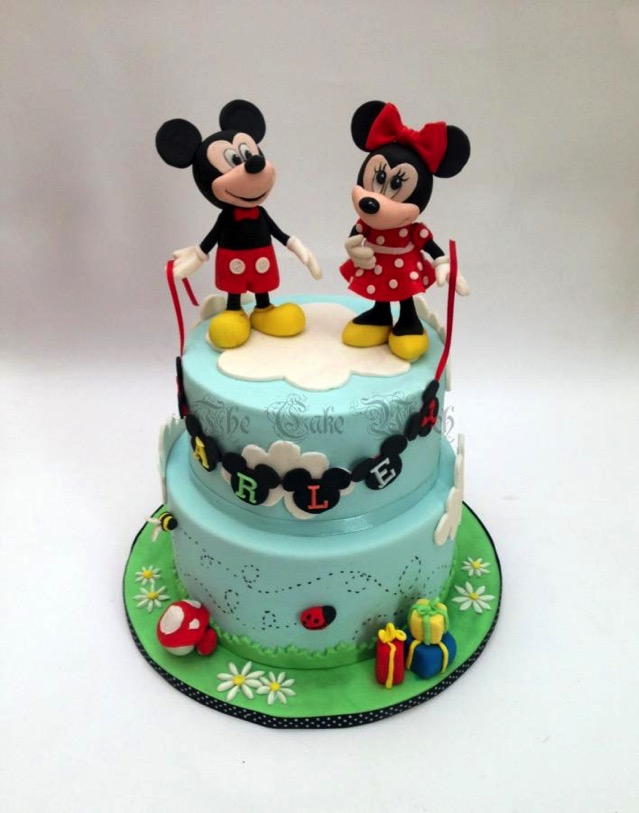 Mickey And Minnie Mouse Are In The Clouds On This Birthday Cake Between The Pages Blog