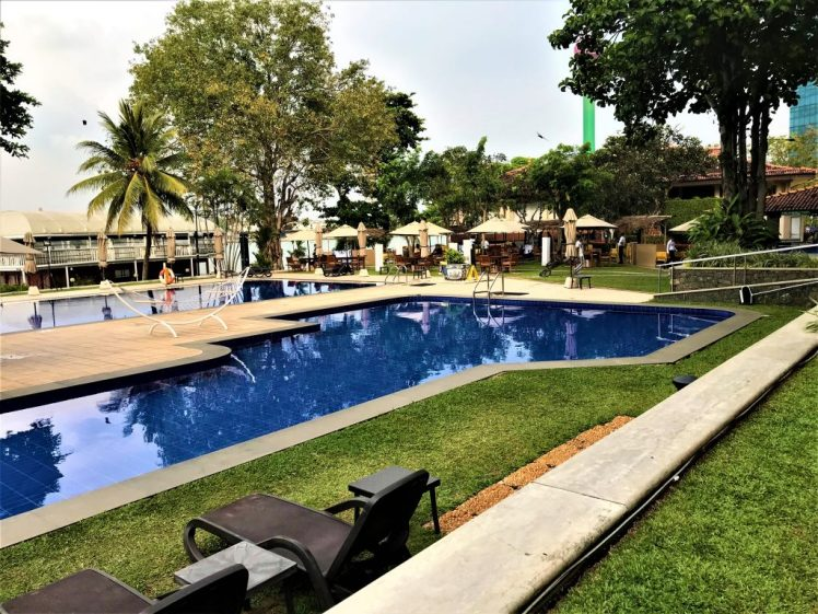 The pool at Cinnamon Lakeside in Colombo. The pool is large, with sun loungers and a pool bar to relax with