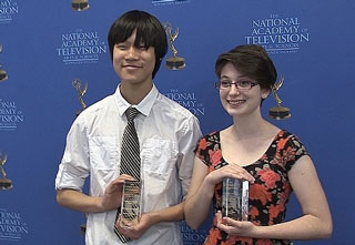 Daniel Lee and Emily Auday show off their first-place trophies