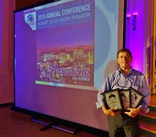 ED Walt Kosmowski shows off BevCam's three 1st place awards