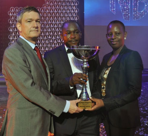 (L-R) Managing Director Nigerian Breweries Plc, Nicolaas Vervelde, National Key Transporter Champion, Emmanuel Usiakpor of Joza Global Logistic Nigerian Breweries Plc, Managing Director' Wife, Clementine Vervelde