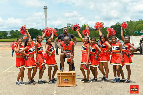 Chinedu Odimgbe, winner of the Enugu Ultimate Chase and cheerleaders