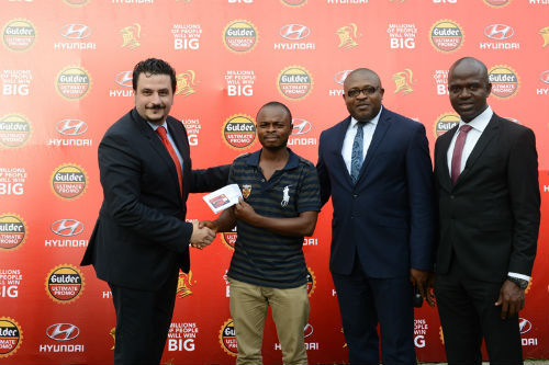 L- Marketing Director Nigerian Breweries Plc, Franco Maria Maggi, Kolawole Ishola winner of N100,000 at Gulder Ultimate Promo raffle draw, Kufre Ekanem Corporate Affairs Adviser, Emmanuel Agu, Marketing Manager, Gulder, More, 33, Life and Stout category, both of Nigerian Breweries Plc during the prize presentation