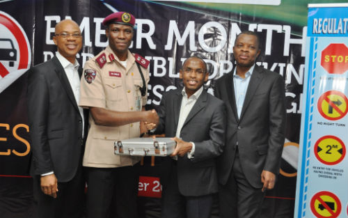 "MD/CEO, Guinness Nigeria, Peter Ndegwa (2nd Right) hands over a set of breathalyser to the Lagos Sector Commander, Federal Road Safety Commission, Mr. Hyginius Omeje, with Head of Policy and Public Affairs, Michael Onuoha, and Corporate Relations Director, Sesan Sobowale both of Guinness Nigeria at the flagoff of the ""Ember Months Responsible Drinking Awareness Campaign"" in Lagos"