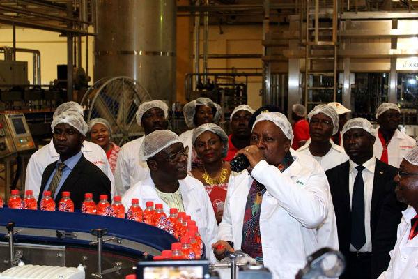 Mr. John Dramani Mahama tasting the new soft drink