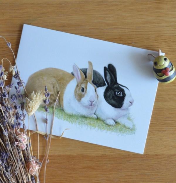 Black and brown rabbits greetings card