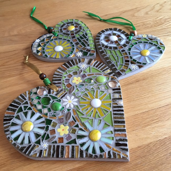 Green and yellow daisy mosaic hearts
