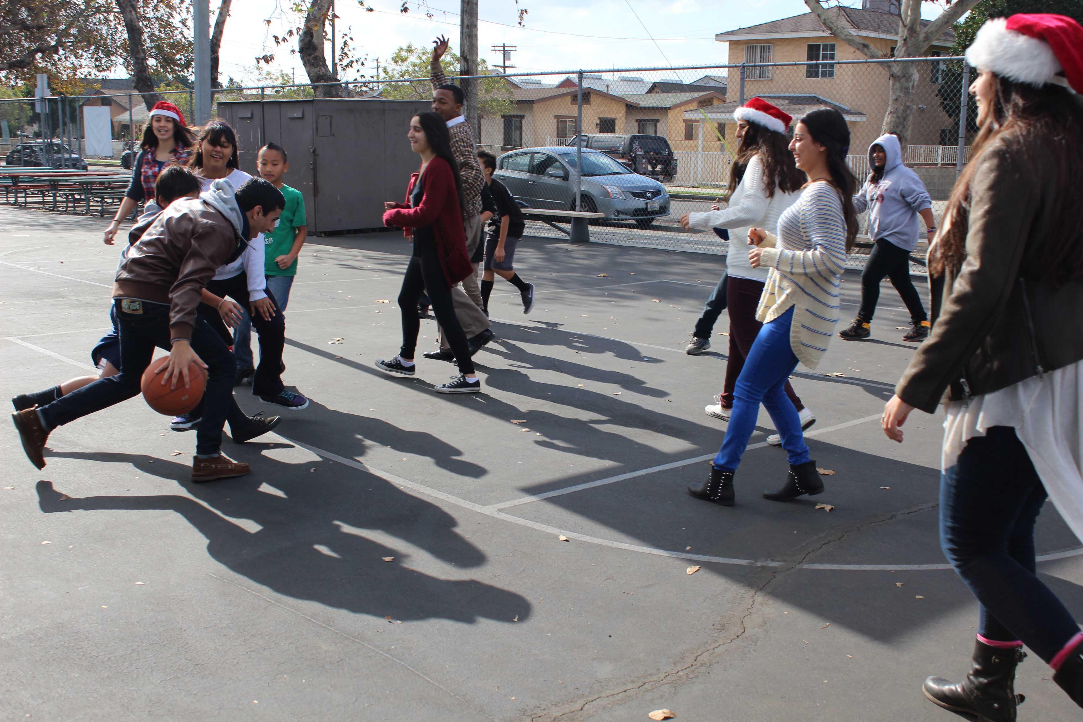 Seniors Matthew Ghermezi, Jessica Mehraban and Alex Eljam finish up a game of basketball.