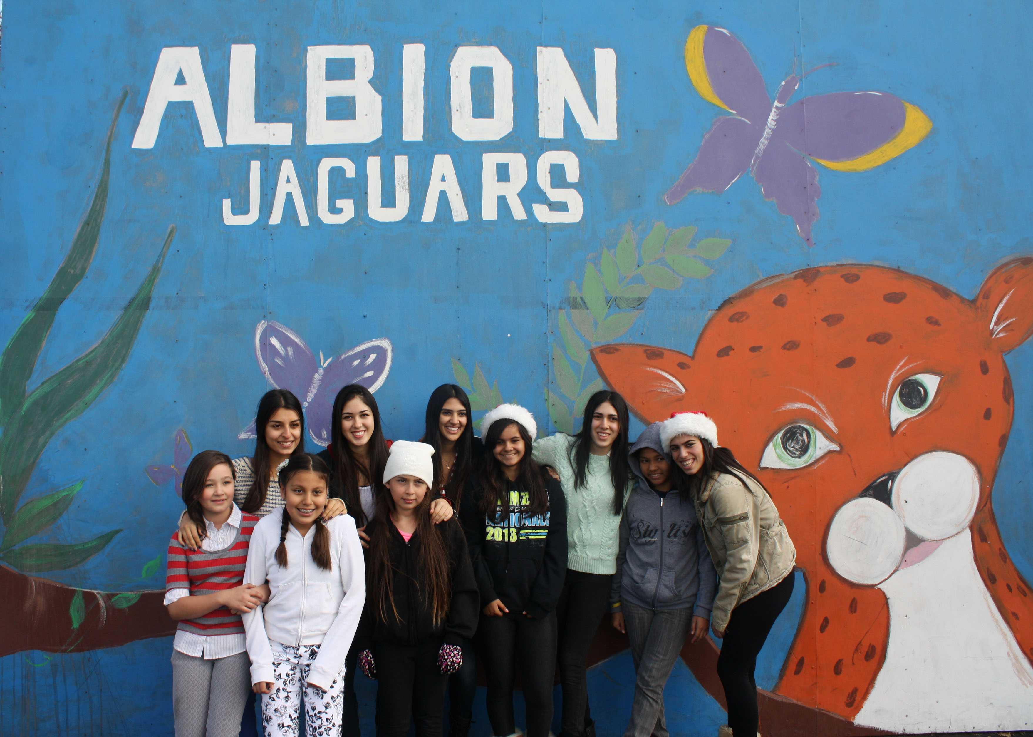 Seniors Jessica Mehraban, Nicole Mehdian, Daniella Ashoori, Brenda Mehdian and Celine Hakimianpour pose with Albion students.