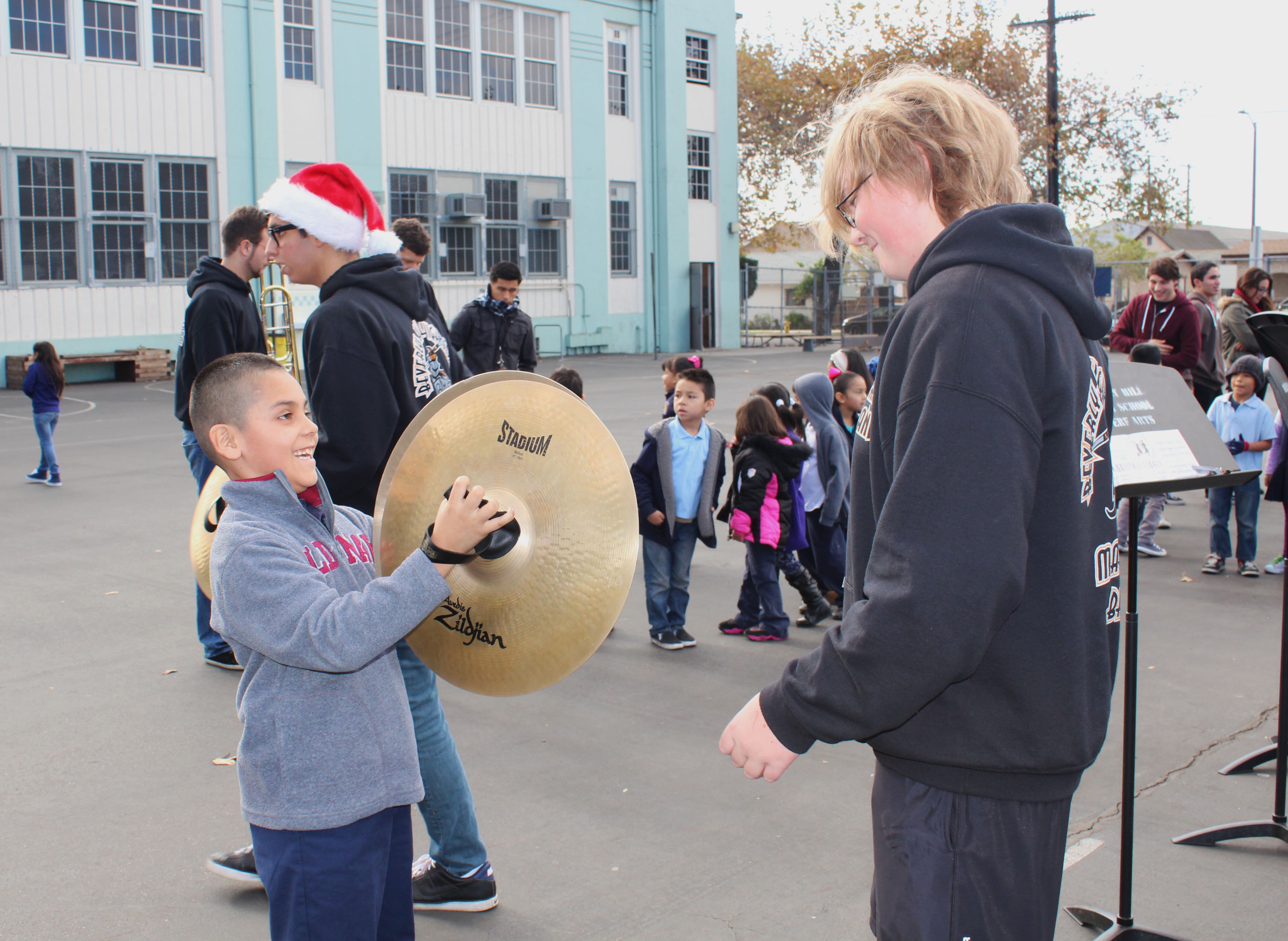 The marching band performed for students during recess, and some of the Albion kids had the opportunity to test out instruments.
