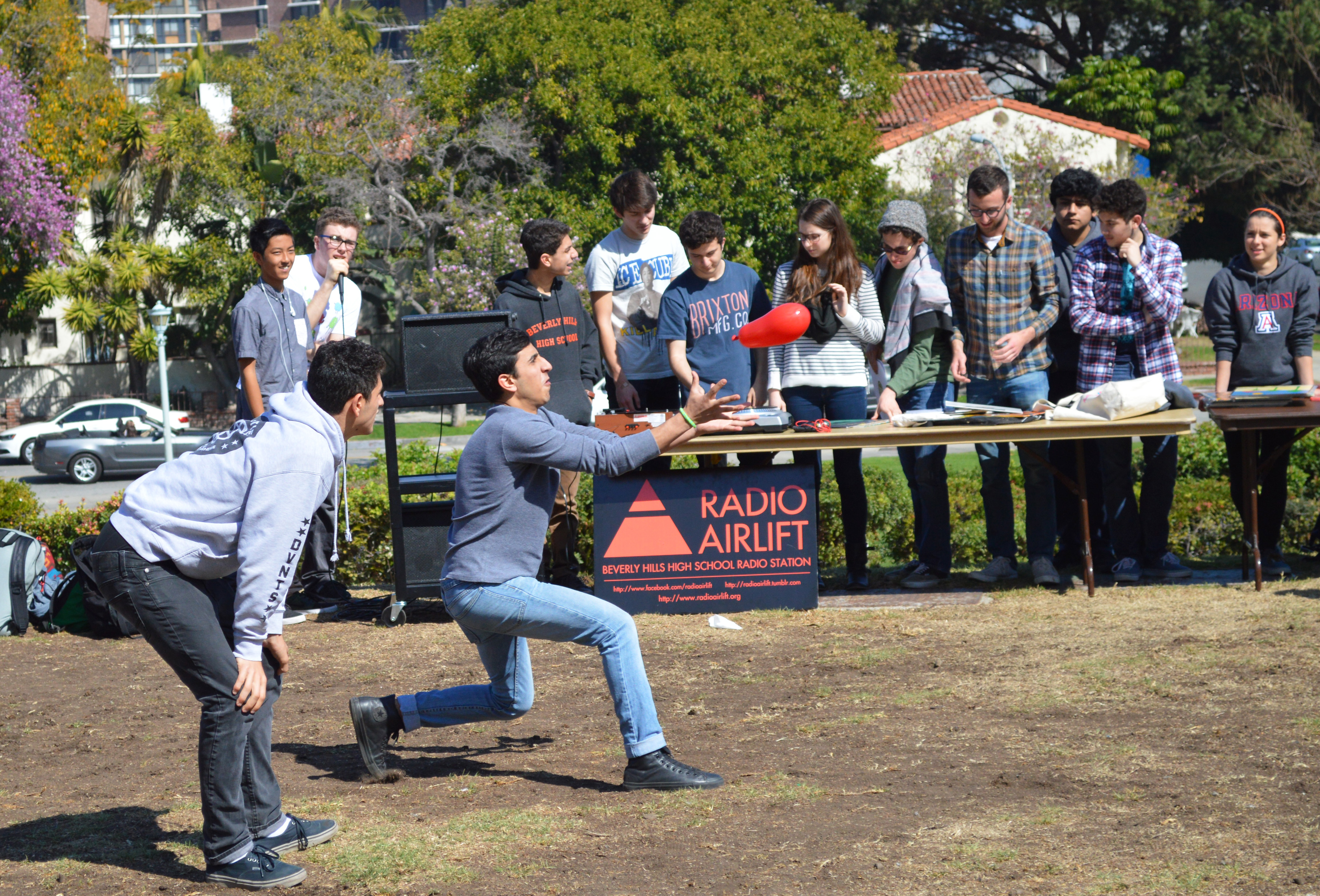 Junior and senior pairs take part in the water balloon toss.