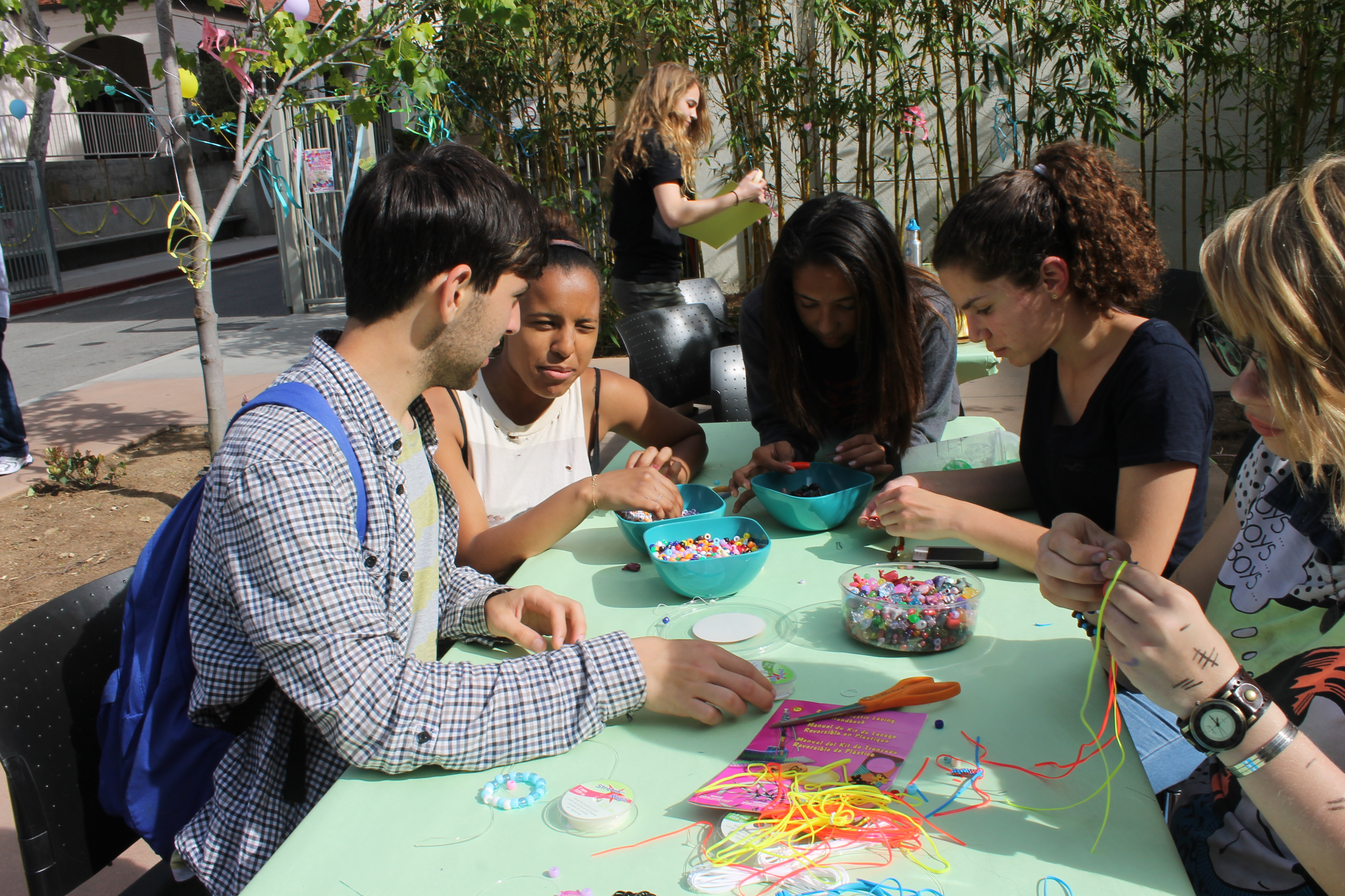 Attendees create bracelets and necklaces at the jewelry station.