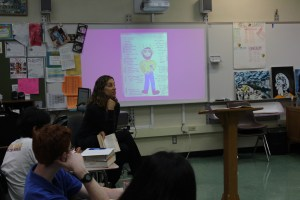 English teacher Julie Goler teaches her sixth period English Honors ¾ class with a PowerPoint from the book, The Canterbury Tales, she is describing.