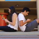 Teenage obsession with technology causes rifts in relationships. Photo by: GUY GINSBERG