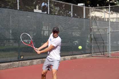 Senior co-captain Emilio Yera prepares to hit the tennis ball. Photo by: Karen Shilyan