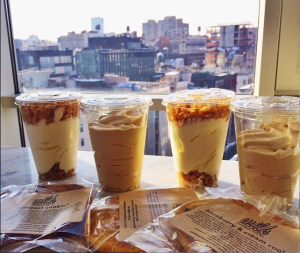 Postmates' Momofuku Milk Bar delivery and the New York City skyline create the perfect setting. Photo By: JULIETTE DEUTSCH
