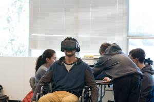 Students at Hack GenY test their virtual wheelchair simulator, which won third place