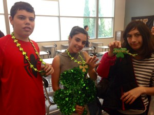 TUCH president Lauren Moghavem and club members Steven Birnbaum and Rona Simoni show their St. Patrick's Day spirit at the clubs lunch meeting.