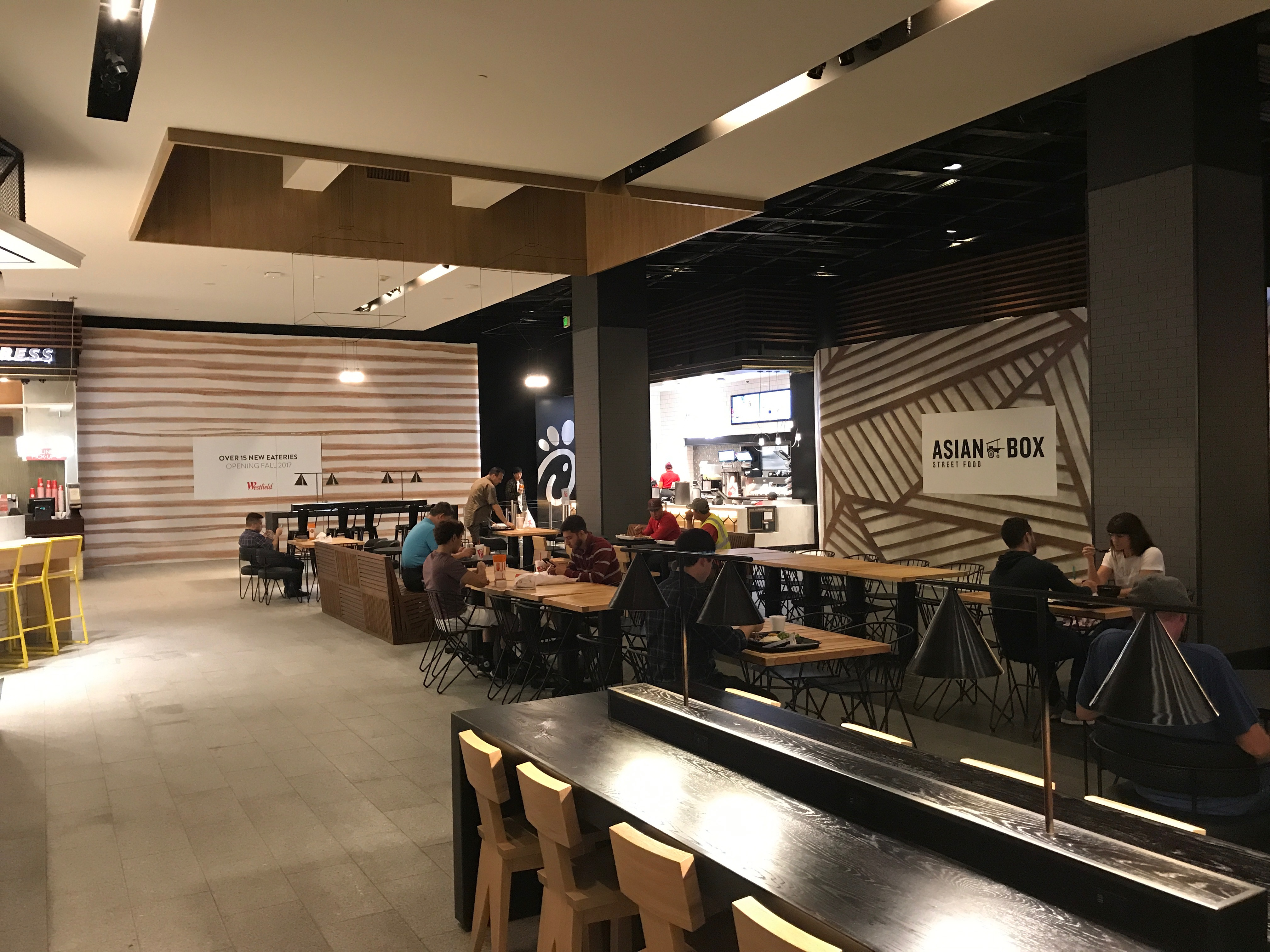 Customers enjoy the newly furnished food court and recently opened Chick-Fil-A.