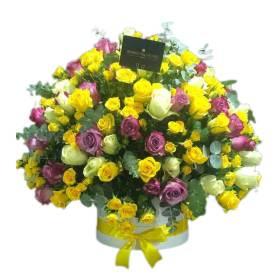 Yellow, White & Purple roses in Round Box