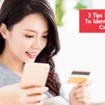 Image_of_woman_holding_cell_phone_and_credit_card_shopping_online