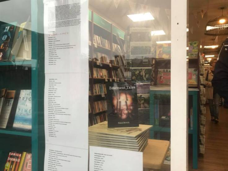 Basement Tales book cover in window display of Kenilworth Books