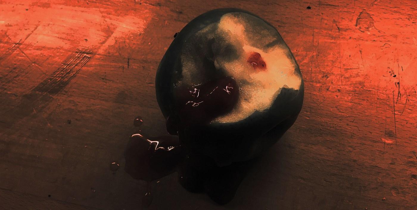 Photoshopped image of a bleeding apple