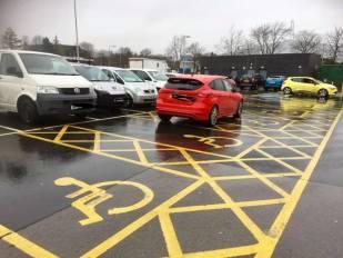 bad parking across multiple handicap spaces