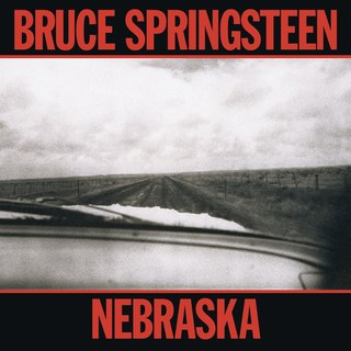 Nebraska album cover Bruce Springsteen. View of a deserted road from a car windsceen