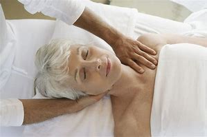Elderly woman receiving Senior Massage