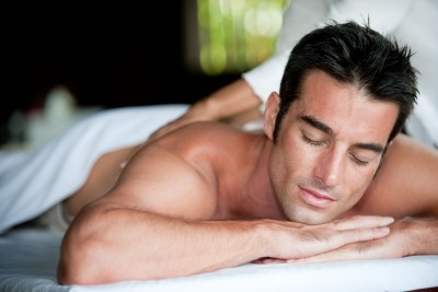 Man receiving massage picture used on massage gift certificate page on Be Well Holistic Massage Wellness Center website