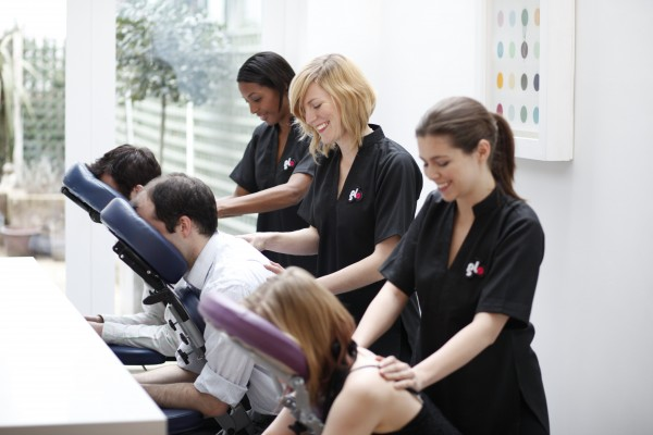 Employees getting event chair massage at a business