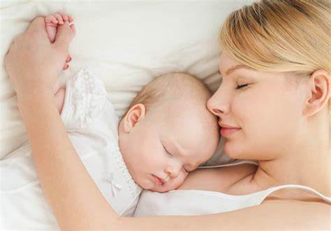 mother and child receiving postnatal massage