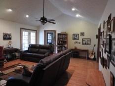 Living room, french doors on left, dining area through door. Front door is to the right.