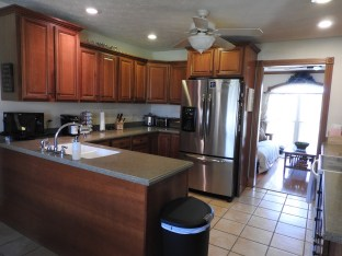 Solid wood cabinets, granite countertops, and a tray ceiling make this a lovely kitchen.