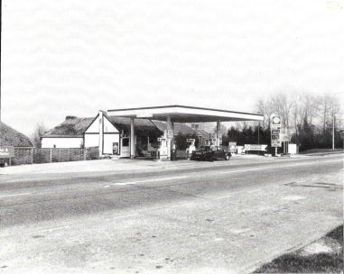 Similar view in the 1980s showing the extended workshop and canopy .