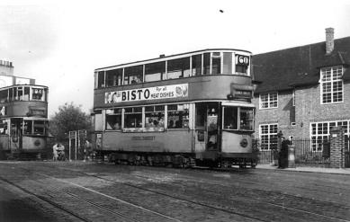103 route 60 to Dulwich Library with tram on 94 behind, post-war