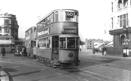 109 route 60 to Southwark, tram & RT bus in background