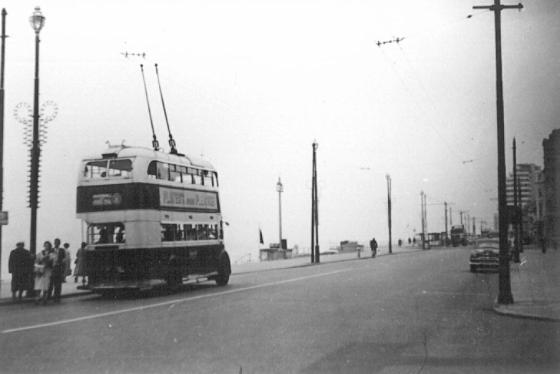 Double-decker trolley westbound Grand Parade St Leo, rear view 1958