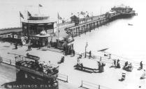 Eastbound tram passing Hastings pier c1910