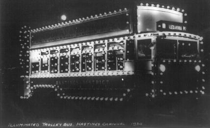 Open top d-d trolley illuminated for carnival 1934