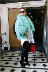 Ahead of the trend at the time, Rita mixed textures in this fluffy turquoise Sesame Street-inspired jacket and leather trousers combo at the BBC Maida Vale studios, August 2012