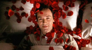 "The movie ""American Beauty"", directed by Sam Mendes and written by Alan Ball. Seen here, Kevin Spacey as Lester Burnham fantasizing about Angela Hayes on a bed of red rose petals. Initial theatrical wide release October 1, 1999. Screen capture. © 1999 DreamWorks. Credit: © 1999 DreamWorks / Flickr / Courtesy Pikturz. Image intended only for use to help promote the film, in an editorial, non-commercial context."