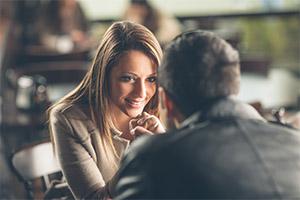 Man making eye contact with a woman - main