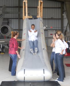 emergency flight attendant training on slide