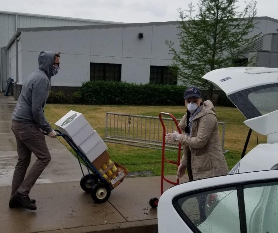 Volunteers hauling groceries at the Food Bank