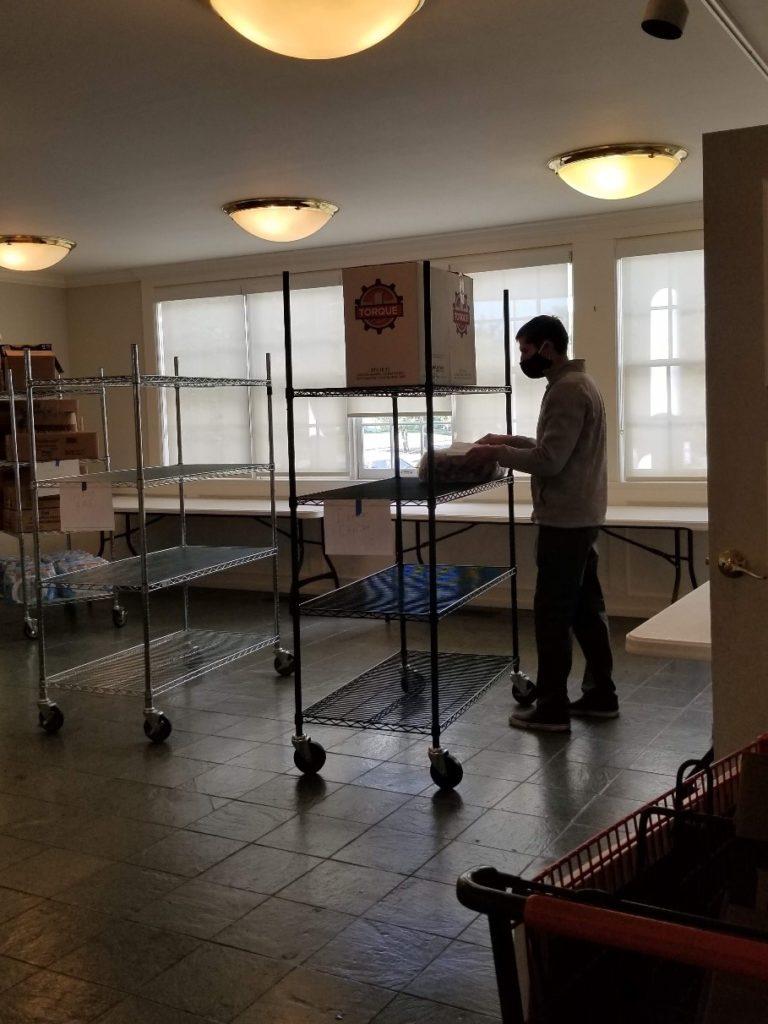 A volunteer works in our food pantry