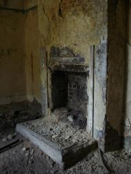 A fireplace in a guard building or something similar at the entrance.