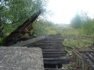 A wooden stockpile perhaps used int he transportation of components