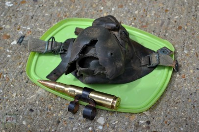 A .50 cal bullet and respirator of Gary's